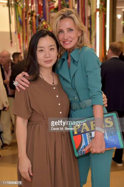 Edeline Lee and Marie Moatti attend The Art of Wishes preview and opening reception ahead of the The Art of Wishes Gala and Auction in aid of...