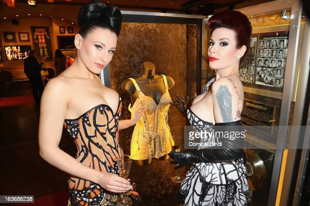 Eden and Lily of The Valley members of the music group The Sinderellas pose at the opening of the exhibition Hard Rock Couture Music Inspired Fashion...