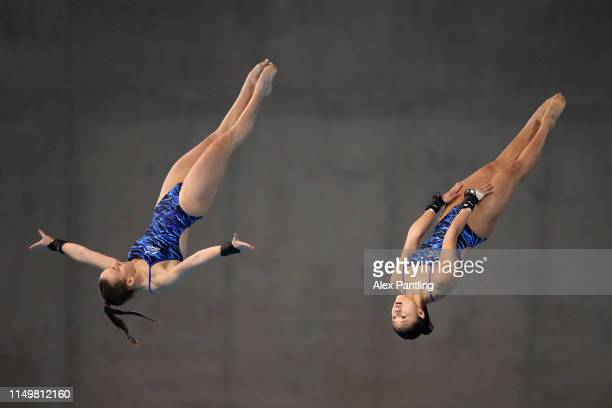 Eden Cheng and synchro partner Lois Toulson of Great Britain compete in the Women's 10m Synchro Platform during the FINA World Diving Series at...