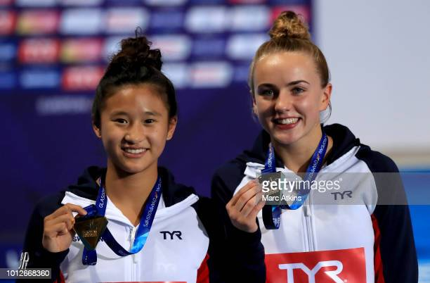 Eden Cheng of Great Britain and Lois Toulson of Great Britain pose with their Gold medals after winning the Women's Synchronised 10m Platform Final...