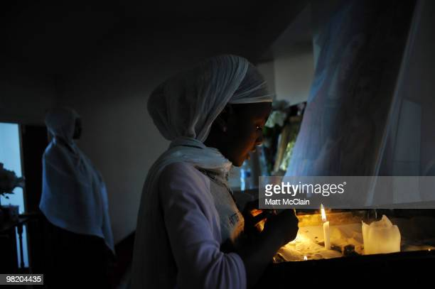 Eden Hailu lights candles at the Ethiopian Orthodox Church April 1 2010 in Denver Colorado Members of the Ethiopian Orthodox Church celebrated Holy...