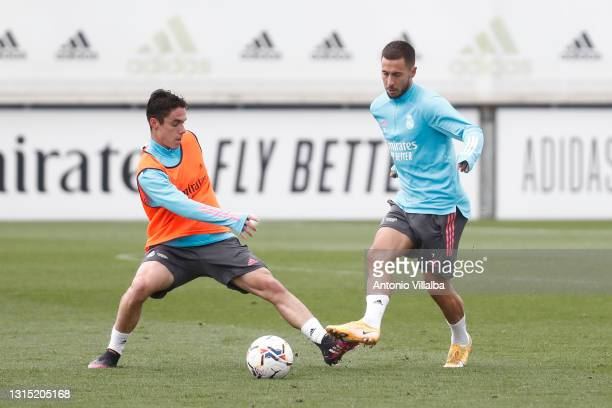 Eden Hazard and Arribas both of Real Madrid are training at Valdebebas training ground on April 29, 2021 in Madrid, Spain.