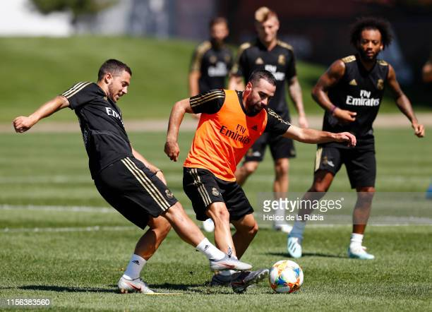 Eden Hazard and Dani Carvajal of Real Madrid perform continuous race exercises in their new preseason training session on July 18 2019 in Montreal...