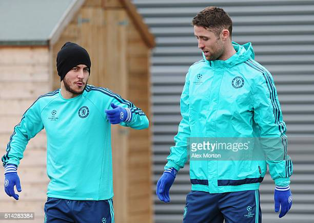 Eden Hazard and Gary Cahill in discussion during a Chelsea training session ahead of their UEFA Champions League round of 16 second leg match against...