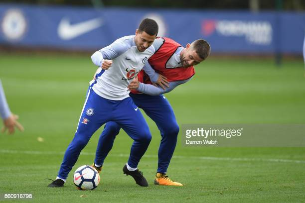Eden Hazard and Gary Cahill of Chelsea during a training session at the Cobham Training Ground on October 13 2017 in Cobham England