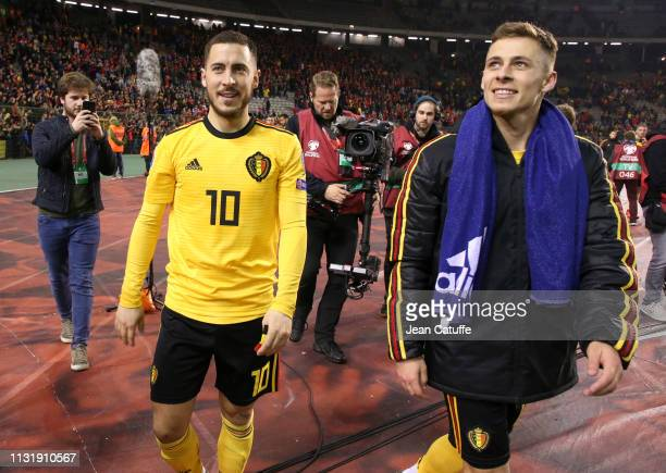 Eden Hazard and his brother Thorgan Hazard of Belgium celebrate the victory following the 2020 UEFA European Championships group I qualifying match...