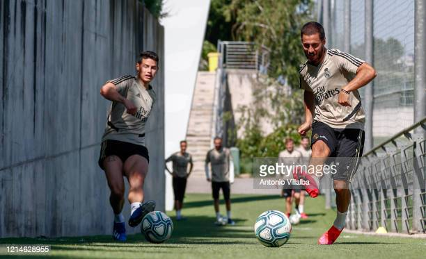 Eden Hazard and James Rodriguez of Real Madrid kick the ball during the team's training session amid Covid19 pandemic at Valdebebas training ground...
