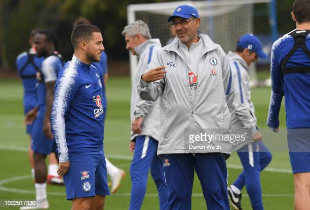 Eden Hazard and Maurizio Sarri of Chelsea during a training session at Chelsea Training Ground on August 24 2018 in Cobham England