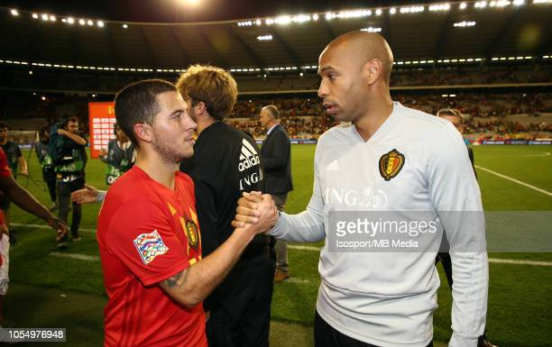 Eden Hazard and Thierry Henry celebrate after winning the UEFA Nations League A group two match between Belgium and Switzerland at King Baudouin...