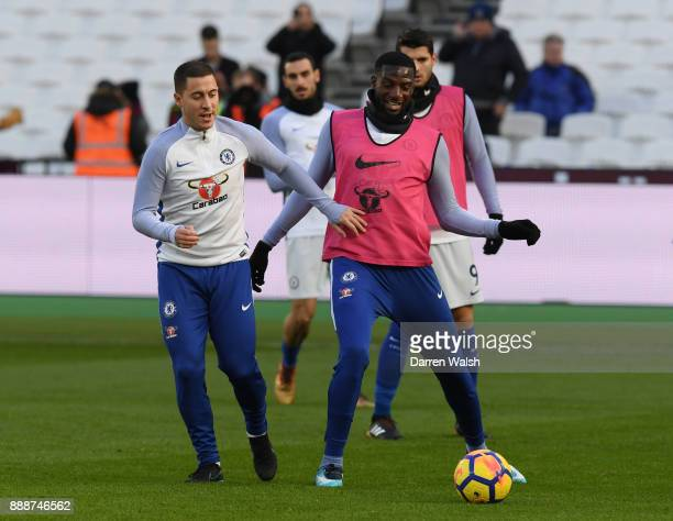 Eden Hazard and Tiemoue Bakayoko of Chelsea warm up prior to the Premier League match between West Ham United and Chelsea at London Stadium on...