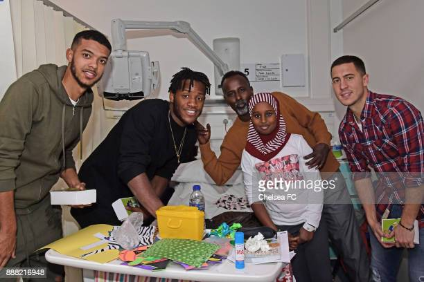 Eden Hazard Michy Batshuayi and Jake ClarkeSalter of Chelsea at the Chelsea and Westminster Hospital on December 7 2017 in London England