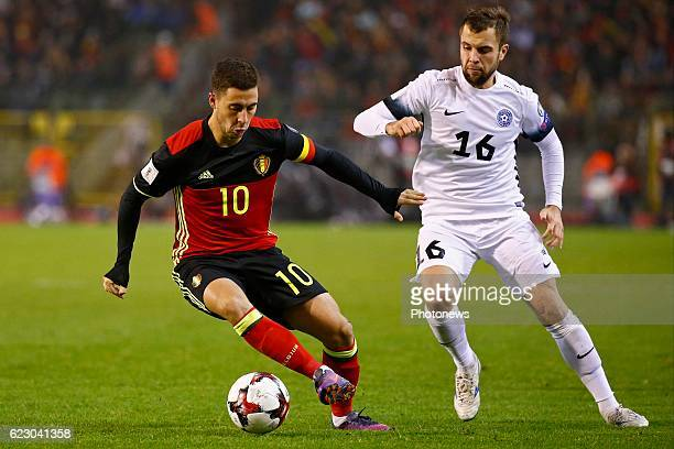 Eden Hazard midfielder of Belgium and Sergei Mosnikov midfielder of Estonia during the World Cup Qualifier Group H match between Belgium and Estonia...