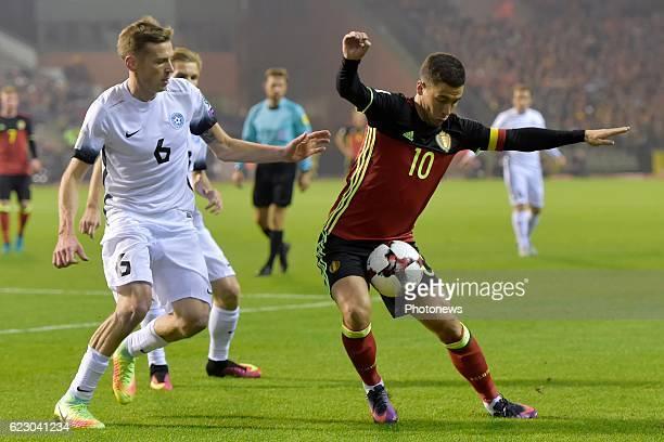 Eden Hazard midfielder of Belgium battles for the ball with Aleksandr Dmitrijev midfielder of Estonia during the World Cup Qualifier Group H match...