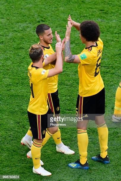 Eden Hazard midfielder of Belgium celebrates scoring a goal with teammates Dries Mertens forward of Belgium and Axel Witsel midfielder of Belgium...