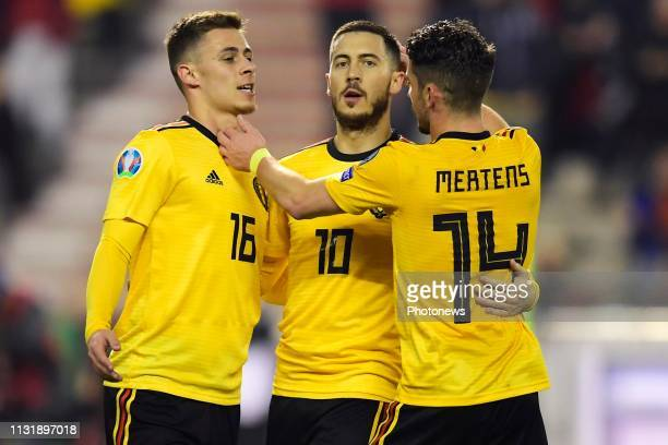 Eden Hazard midfielder of Belgium celebrates scoring a penalty with Thorgan Hazard midfielder of Belgium and Dries Mertens forward of Belgium during...
