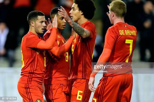 Eden Hazard midfielder of Belgium celebrates scoring the opening goal with teammates Axel Witsel midfielder of Belgium Youri Tielemans midfielder of...