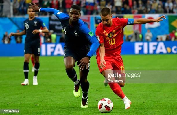 Eden Hazard midfielder of Belgium Paul Pogba midfielder of France during the FIFA 2018 World Cup Russia SemiFinal match between France and Belgium at...