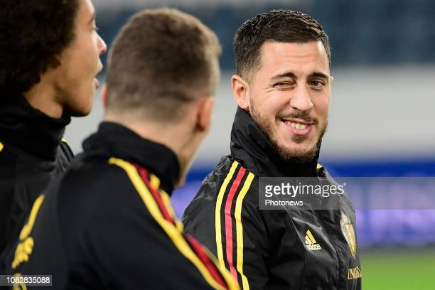 Eden Hazard midfielder of Belgium pinch an eye to his brother Thorgan Hazard midfielder of Belgium during a training session a day prior to the UEFA...