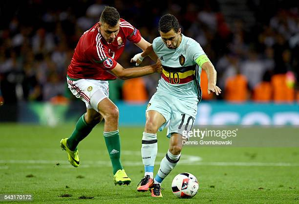 Eden Hazard of Belgium and Adam Szalai of Hungary compete for the ball during the UEFA EURO 2016 round of 16 match between Hungary and Belgium at...