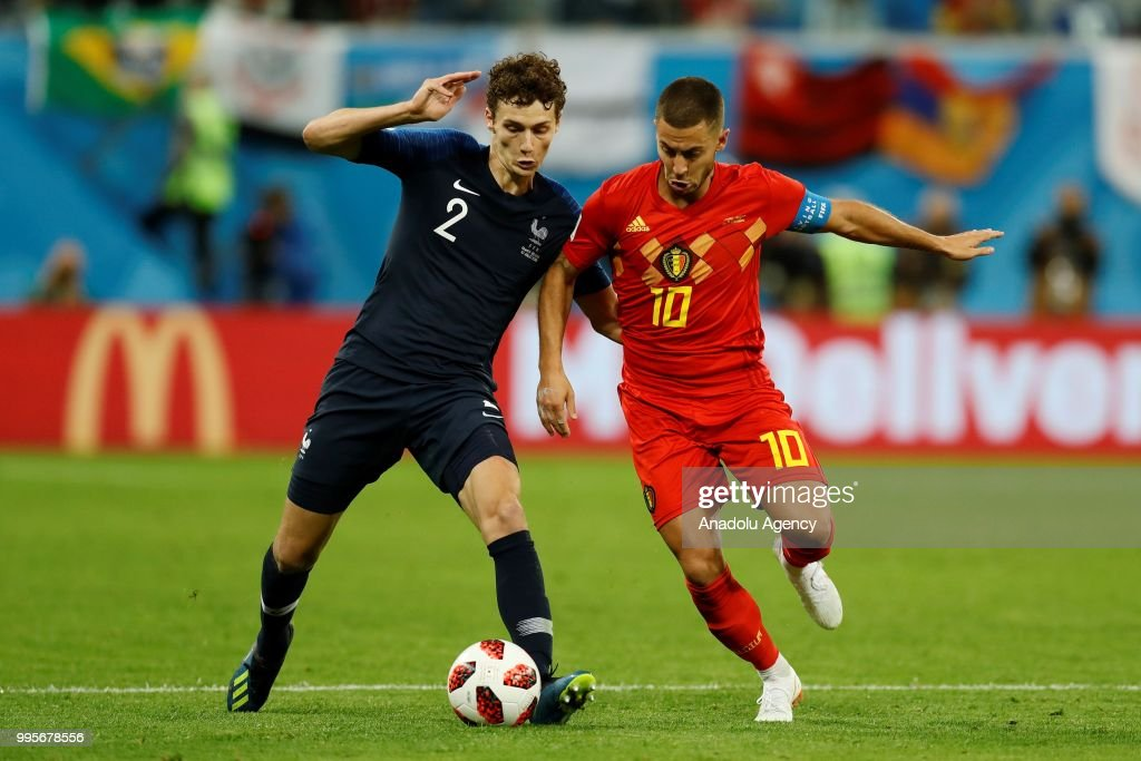 Eden Hazard of Belgium (R) and Benjamin Pavard of France vie for the ball during the 2018 FIFA World Cup Russia semi final match between France and Belgium at the Saint Petersburg Stadium in Saint Petersburg, Russia on July 10, 2018.