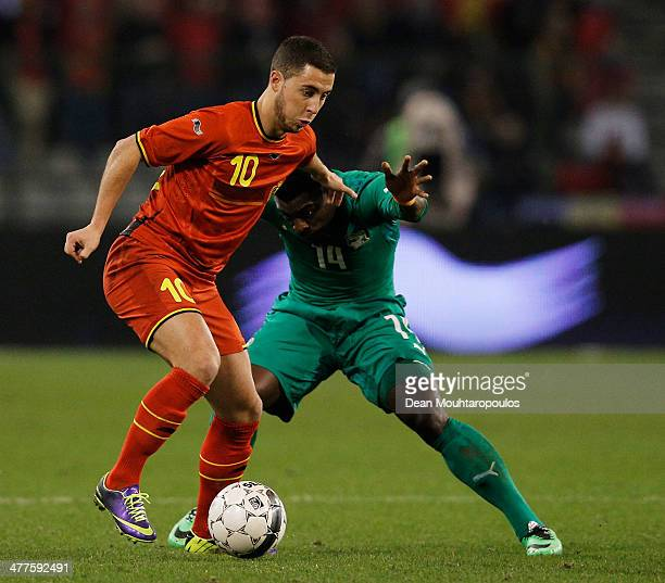 Eden Hazard of Belgium and Christopher Aurier of Ivory Coast battle for the ball during the International Friendly match between Belgium and Ivory...