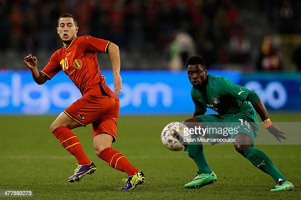Eden Hazard of Belgium and Christopher Aurier of Ivory Coast in action during the International Friendly match between Belgium and Ivory Coast at The...