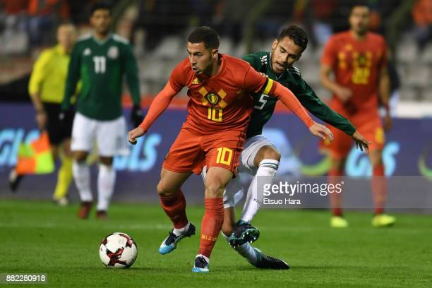 Eden Hazard of Belgium and Diego Reyes of Mexico compete for the ball during the international friendly match between Belgium and Mexico at King...