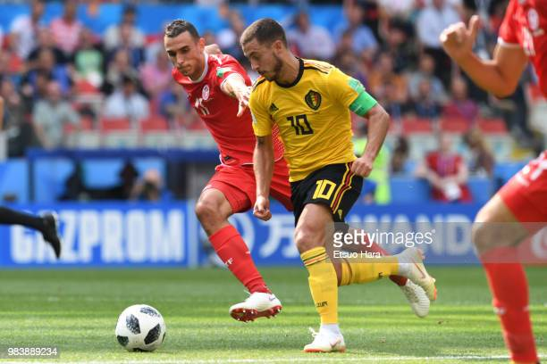Eden Hazard of Belgium and Ellyes Skhiri of Tunisia compete for the ball during the 2018 FIFA World Cup Russia group G match between Belgium and...