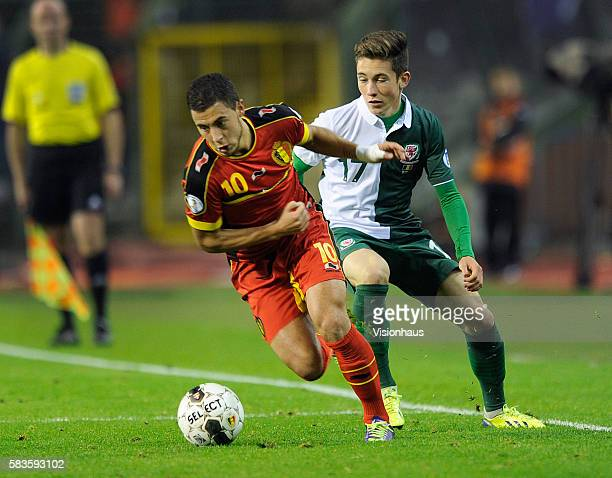 Eden Hazard of Belgium and Harry Wilson of Wales in action during the FIFA 2014 World Cup Qualifying Group A match between Belgium and Wales at the...