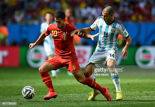 Eden Hazard of Belgium and Javier Mascherano of Argentina compete for the ball during the 2014 FIFA World Cup Brazil Quarter Final match between...
