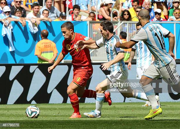 Eden Hazard of Belgium and Lionel Messi of Argentina in action during the 2014 FIFA World Cup Brazil Quarter Final match between Argentina and...