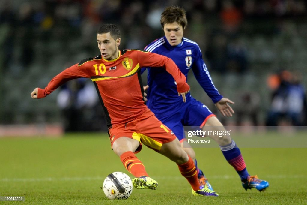 Eden Hazard of Belgium battles for the ball with Sakai Gotoku of Japan during the pre World Cup international friendly match between Belgium and Japan on November 19, 2013 in Brussels, Belgium
