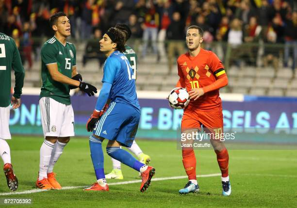 Eden Hazard of Belgium celebrates his goal while Hector Moreno of Mexico and goalkeeper of Mexico Guillermo Ochoa look on during the international...