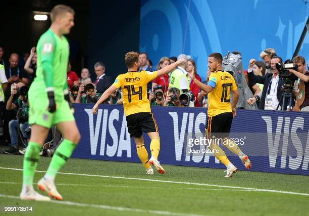 Eden Hazard of Belgium celebrates his goal with Dries Mertens while goalkeeper of England Jordan Pickford looks on during the 2018 FIFA World Cup...