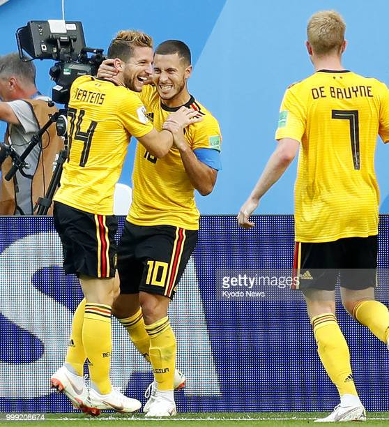 Eden Hazard of Belgium celebrates with his teammate Dries Mertens after scoring his side's second goal against England during the second half of the...