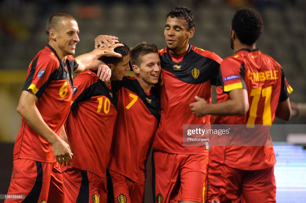 Eden Hazard (2nd L) of Belgium celebrates with team-mates Timmy Simons (L), Dries Mertens (3rd L), Igor De Camargo (2nd R) and Moussa Dembele after scoring the 2-0 goal during the UEFA EURO 2012 Group A qualifying match between Belgium and Kazakhstan at King Baudouin Stadium on October 7, 2011 in Brussels, Belgium.