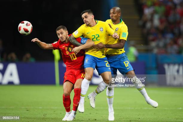 Eden Hazard of Belgium competes with Fagner and Fernandinho of Brazil during the 2018 FIFA World Cup Russia Quarter Final match between Brazil and...