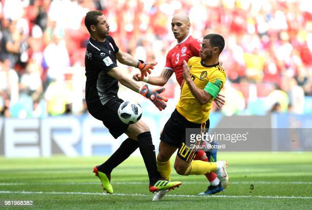 Eden Hazard of Belgium dribbles Farouk Ben Mustapha of Tunisia before scoring his team's fourth goal during the 2018 FIFA World Cup Russia group G...