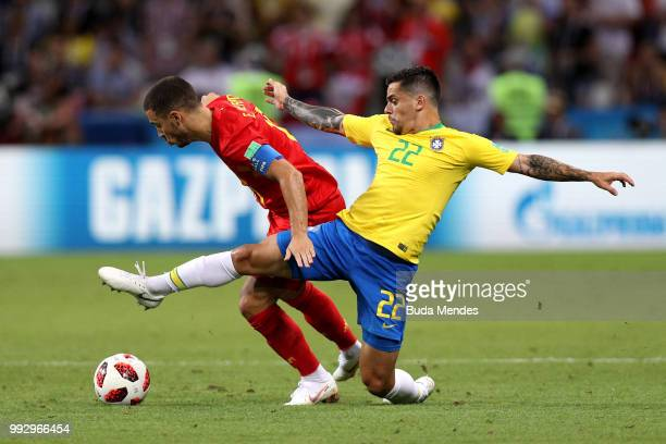 Eden Hazard of Belgium ia tackled by Fagner of Brazil during the 2018 FIFA World Cup Russia Quarter Final match between Brazil and Belgium at Kazan...