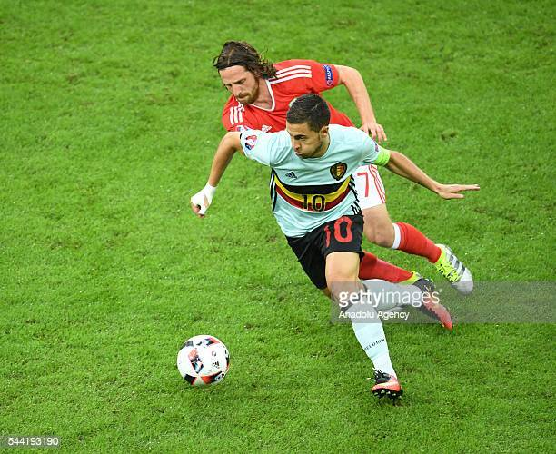 Eden Hazard of Belgium in action against Joe Allen of Wales during the Euro 2016 quarterfinal football match between Wales and Belgium at the Stadium...