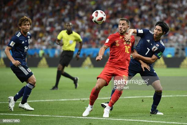 Eden Hazard of Belgium is challenged by Gaku Shibasaki of Japan during the 2018 FIFA World Cup Russia Round of 16 match between Belgium and Japan at...