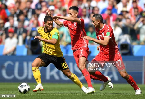 Eden Hazard of Belgium is challenged by Saifeddine Khaoui of Tunisia and Ellyes Skhiri of Tunisia during the 2018 FIFA World Cup Russia group G match...