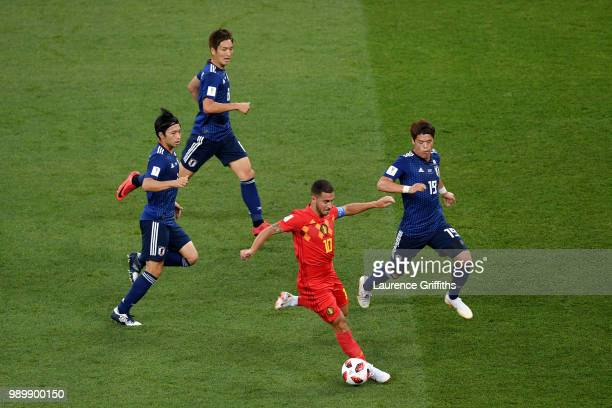 Eden Hazard of Belgium is closed down by Gaku Shibasaki, Hiroki Sakai and Genki Haraguchi of Japan during the 2018 FIFA World Cup Russia Round of 16...