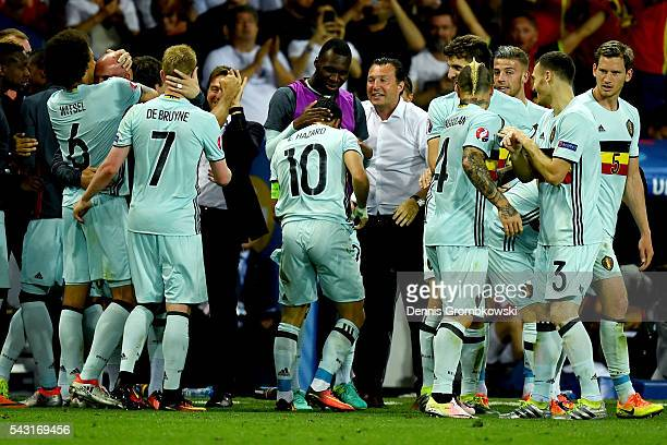 Eden Hazard of Belgium is congratulated by his team mate Christian Benteke and manager Marc Wilmots after scoring their team's third goal during the...
