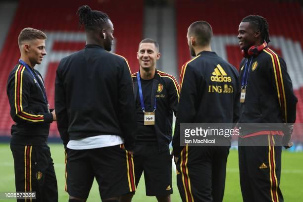 Eden Hazard of Belgium is pictured speaking to Dedryck Boyata Michy Batshuayi Thorgan Hazard and Yannick Carrasco prior to the International Friendly...