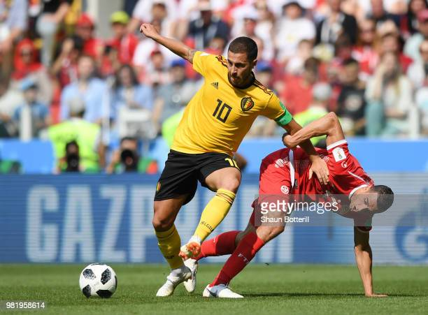 Eden Hazard of Belgium is tackled by Ellyes Skhiri of Tunisia during the 2018 FIFA World Cup Russia group G match between Belgium and Tunisia at...