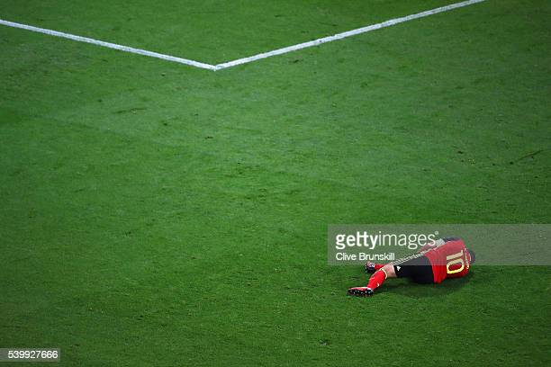 Eden Hazard of Belgium lies injured during the UEFA EURO 2016 Group E match between Belgium and Italy at Stade des Lumieres on June 13 2016 in Lyon...