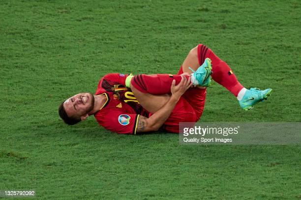 Eden Hazard of Belgium lies injured on the pitch during the UEFA Euro 2020 Championship Round of 16 match between Belgium and Portugal at Estadio La...