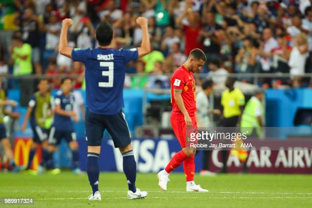 Eden Hazard of Belgium looks dejected as Gen Shoji of Japan celebrates after Takashi Inui of Japan scored a goal to make it 02 during the 2018 FIFA...