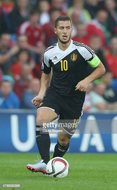 Eden Hazard of Belgium runs with the ball during the UEFA EURO 2016 qualifying match between Wales and Belgium at the Cardiff City Stadium on June 12...